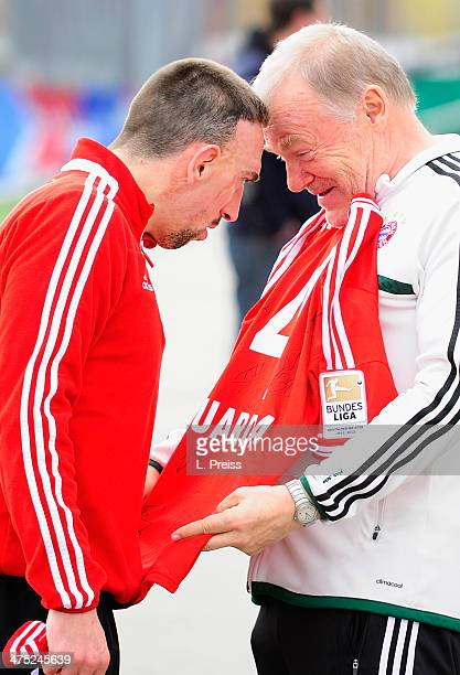 Franck Ribery and coach Hermann Gerland of Muenchen joke after a training session of FC Bayern Muenchen on February 27 2014 in Munich Germany