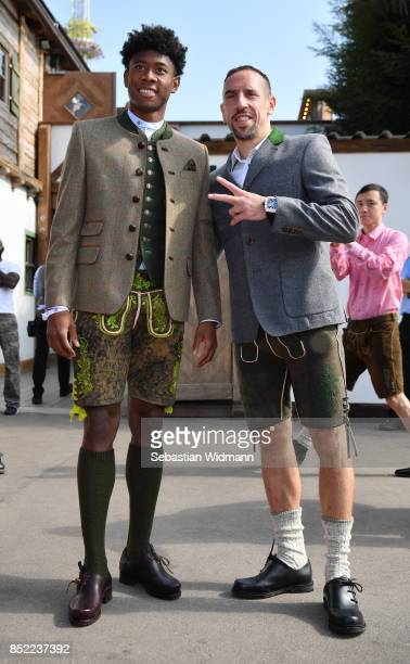Franck Ribery and David Alaba of FC Bayern Muenchen attend the Oktoberfest beer festival at Kaefer Wiesnschaenke tent at Theresienwiese on September...