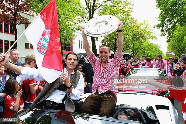 Franck Ribery and his team mate Daniel van Buyten celebrate the German championship with the trophy on the way to the champions party at the...