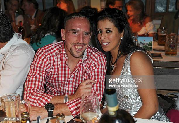 Franck Ribery and his wife Wahiba attend the Oktoberfest beer festival at Kaefer on September 23 2012 in Munich Germany