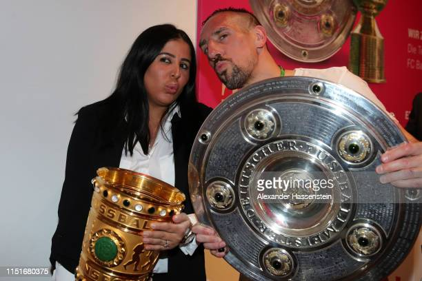 Franck Ribery and his wife Wahiba Ribery pose with the DFB Cup and Bundesliga Championship trophies during the FC Bayern Muenchen DFB Cup final's...