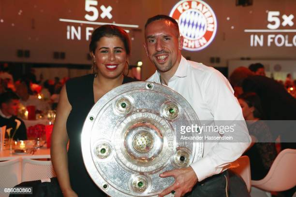 Franck Ribery and his wife Wahiba Ribery pose with the trophy during the FC Bayern Muenchen Championship party following the Bundesliga match between...