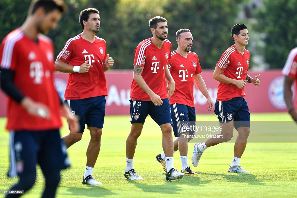 Franck Ribery #7 and James Rodriguez #11 of FC Bayern Muenchen walks during an International Champions Cup FC Bayern training session at Geylang Field on July 24, 2017 in Singapore.