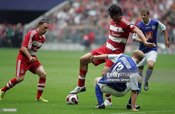 Franck Ribery and Luca Toni of Munich and Tim Sebastian of Rostock in action during the Bundesliga match between Bayern Munich and Hansa Rostock at...