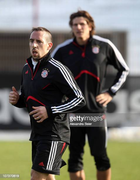Franck Ribery and Mario Gomez exercise during a Bayern Muenchen training session ahead of the Champions League Group E match against FC Basel on...