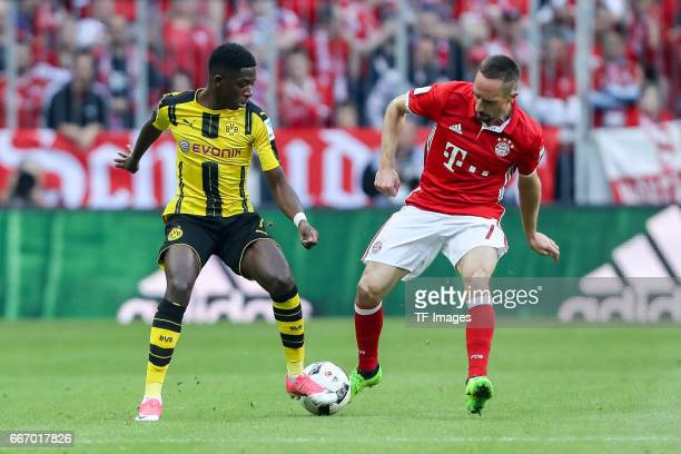 Franck Ribery and Ousmane Dembele of Dortmund battle for the ball during the Bundesliga match between Bayern Muenchen and Borussia Dortmund at...