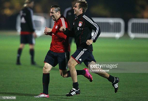 Franck Ribery and Philipp Lahm of Bayern run during the FC Bayern Muenchen training session at Aspire Academy for Sports Excellence training ground...