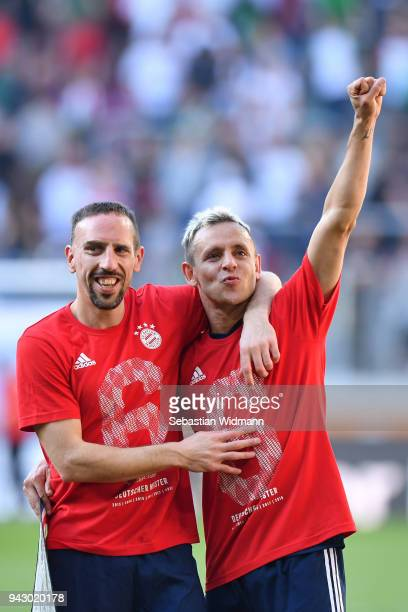 Franck Ribery and Rafinha of Bayern Muenchen celebrate after the Bundesliga match between FC Augsburg and FC Bayern Muenchen at WWKArena on April 7...