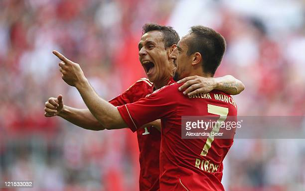 Franck Ribery and Rafinha of Bayern Muenchen celebrate Ribery's first goal during the Bundesliga match between FC Bayern Muenchen and Hamburger SV at...
