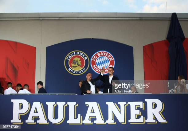 Franck Ribery and Sandro Wagner of FC Bayern Muenchen celebrate winning the Bundesliga with fans in the beer garden at the Paulaner am Nockherberg on...