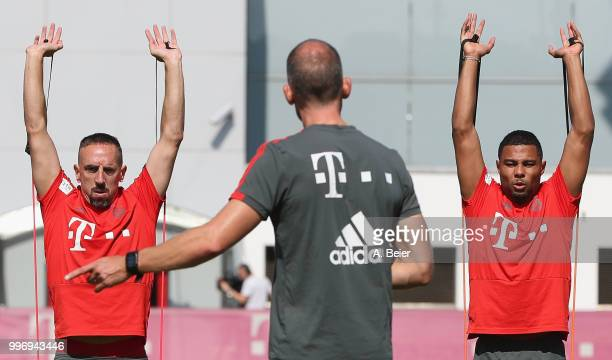 Franck Ribery and Serge Gnabry of FC Bayern Muenchen practice during a training session at the club's Saebener Strasse training ground on July 12...