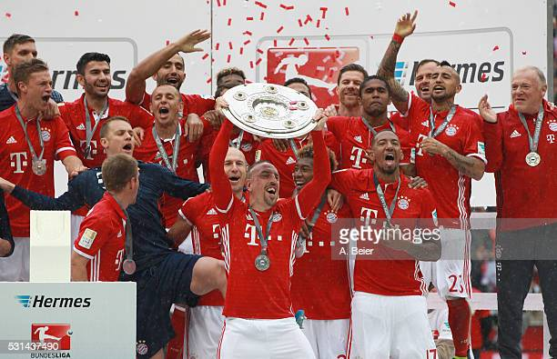 Franck Ribery and the team of Bayern Muenchen celebrates with the German Championship trophy after the Bundesliga match between FC Bayern Muenchen...