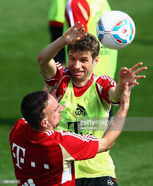 Franck Ribery and Thomas Mueller fight for the ball during a training session of Bayern Muenchen at the ASPIRE Academy for Sports Excellence on...