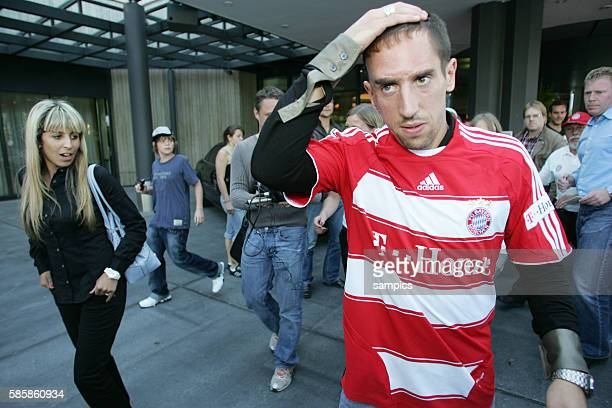 Franck Ribery and wife Wahiba after the press conference to announce his signing at Bayern Munich