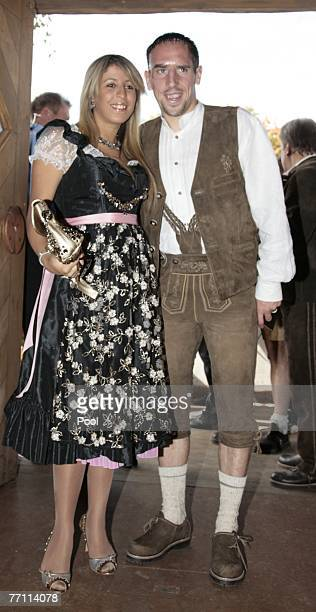 Franck Ribery and wife Wahiba arrive at the Kaefers party tent for a day at the Oktoberfest on September 30 2007 in Munich Germany