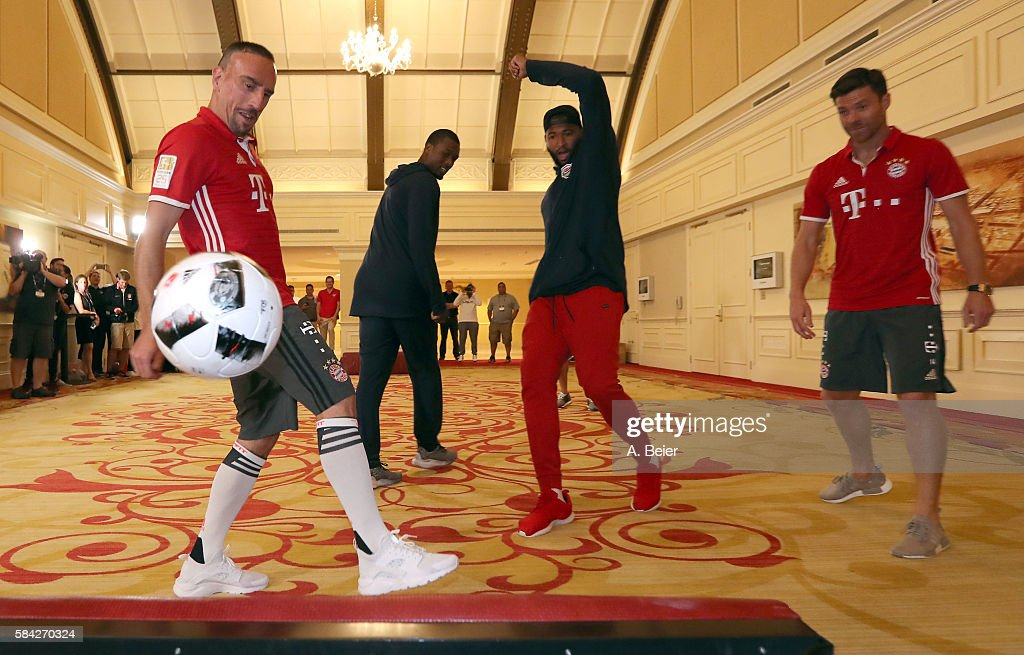 Franck Ribery (L) and Xabi Alonso (R) of Bayern Muenchen play soccer with NBA players DeMarcus Cousins (2ndR) of Sacramento Kings and Harrison Barnes of Dallas Mavericks during an activity session during the AUDI Summer Tour USA 2016 on July 28, 2016 in Chicago, Illinois.