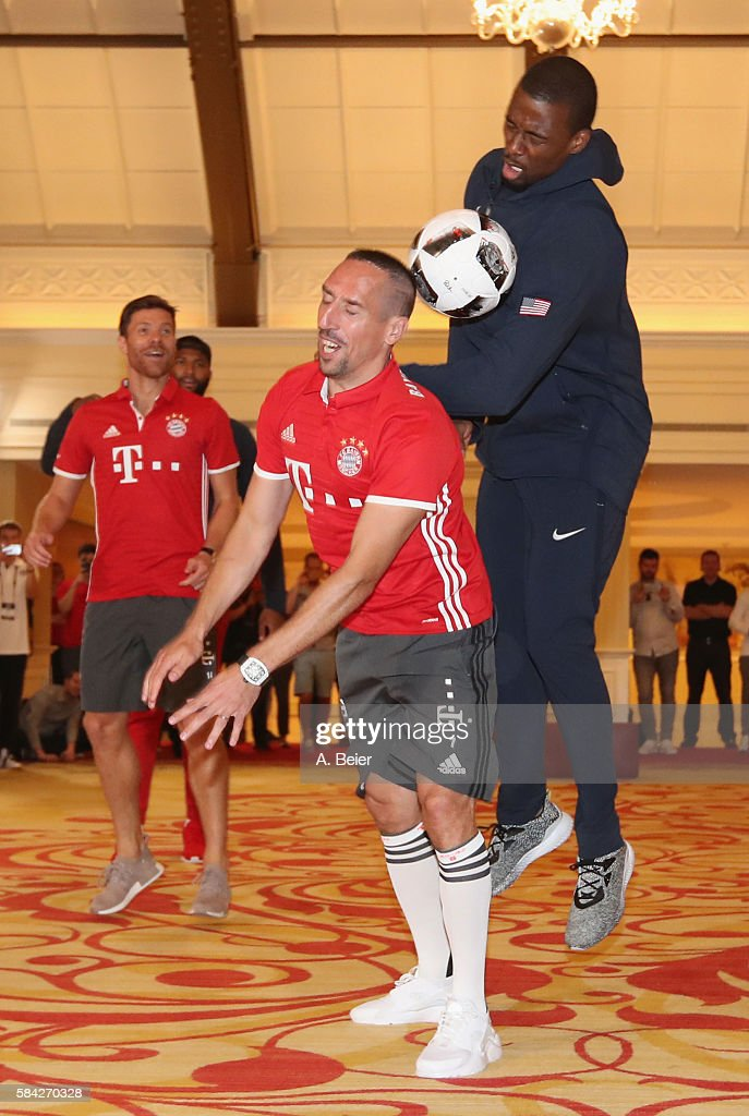 Franck Ribery (2ndR) and Xabi Alonso (L) of Bayern Muenchen play soccer with NBA players DeMarcus Cousins (2ndL) of Sacramento Kings and Harrison Barnes of Dallas Mavericks during an activity session during the AUDI Summer Tour USA 2016 on July 28, 2016 in Chicago, Illinois.