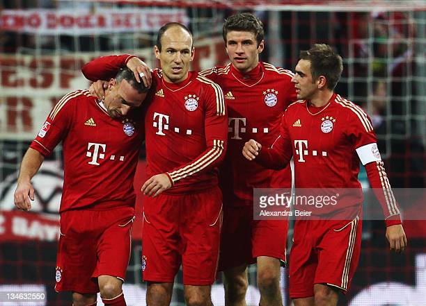 Franck Ribery Arjen Robben Thomas Mueller and Philipp Lahm of Bayern Muenchen celebrates his penalty goal during the Bundesliga match between FC...