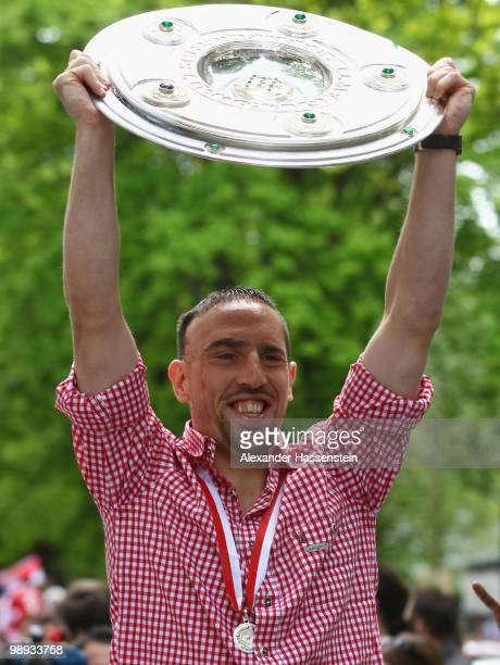 Franck Ribery celebrates the German championship with the trophy on the way to the champions party at the Marienplatz on May 9 2010 in Munich Germany