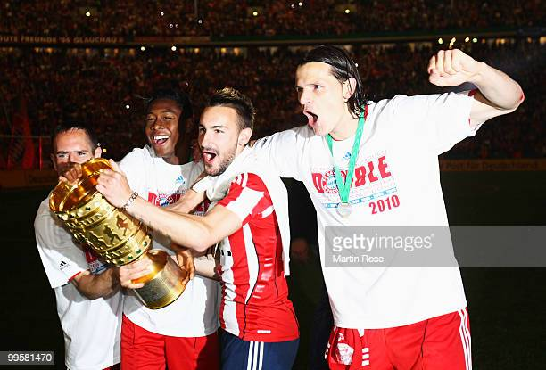 Franck Ribery David Alaba Diego Contento and Daniel van Buyten celebrate with the trophy after winning the DFB Cup final match between SV Werder...