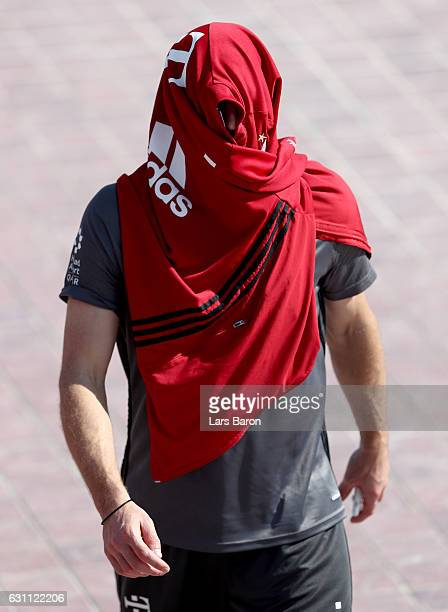 Franck Ribery hides under a jacket after a training session at day 5 of the Bayern Muenchen training camp at Aspire Academy on January 7, 2017 in...