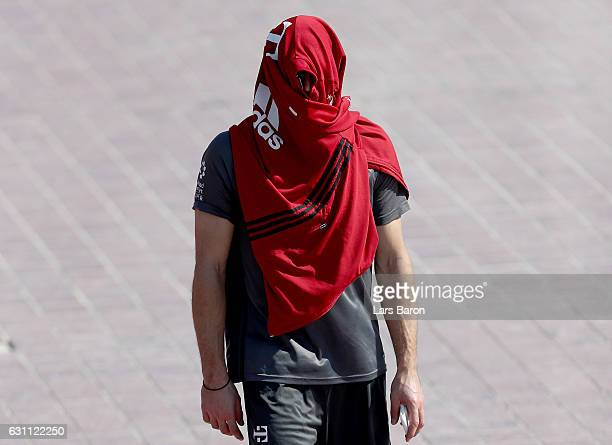 Franck Ribery hides under a jacket after a training session at day 5 of the Bayern Muenchen training camp at Aspire Academy on January 7 2017 in Doha...
