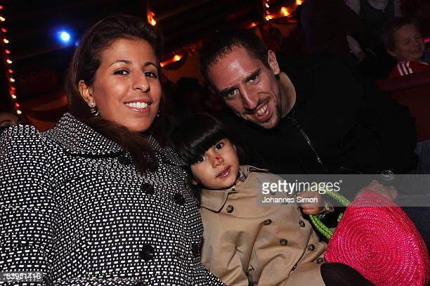 Franck Ribery his wife Wahiba Riberyand their daughter pose during the FC Bayern Circus Gala at the Circus Krone on December 8 2008 in Munich Germany