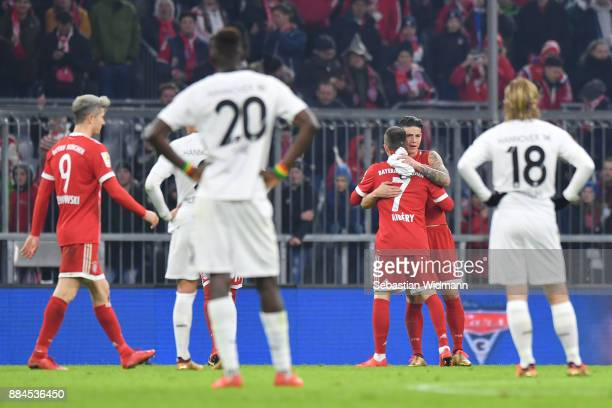 Franck Ribery hugs James Rodriguez of Bayern Muenchen after the final whistle of the Bundesliga match between FC Bayern Muenchen and Hannover 96 at...