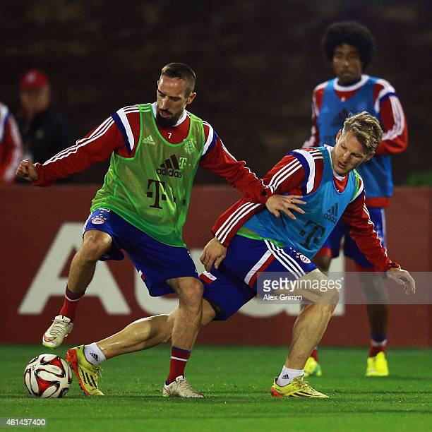 Franck Ribery is challenged by Bastian Schweinsteiger during day 4 of the Bayern Muenchen training camp at ASPIRE Academy for Sports Excellence on...