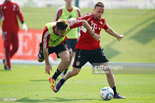 Franck Ribery is challenged by Diego Contento during a training session of Bayern Muenchen at the ASPIRE Academy for Sports Excellence on January 7...