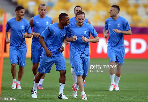 Franck Ribery jokes with Blaisi Matuidi of France during a UEFA EURO 2012 training session at the Olympic Stadium on June 19 2012 in Kiev Ukraine