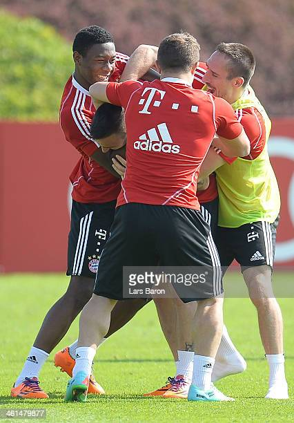 Franck Ribery jokes with David Alaba Diego Contento and Mitchell Weiser during a training session at day 5 of the Bayern Muenchen training camp at...