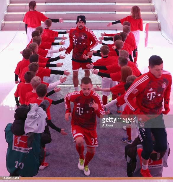 Franck Ribery Joshua Kimmich and Robert Lewandowski of FC Bayern Muenchen are pictured at the players' tunnel for the Bundesliga match between FC...