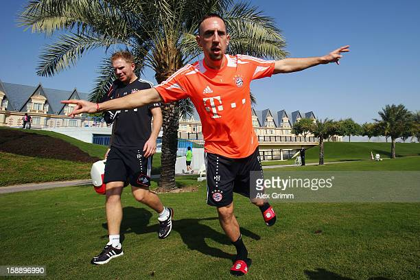 Franck Ribery jumps on his way to a Bayern Muenchen training session at the ASPIRE Academy for Sports Excellence on January 3 2013 in Doha Qatar