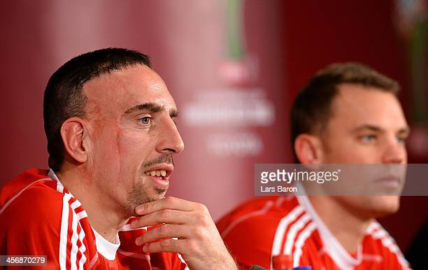 Franck Ribery looks on next to Manuel Neuer during a Bayern Muenchen press conference for the FIFA Club World Cup at Agadir Stadium on December 15...