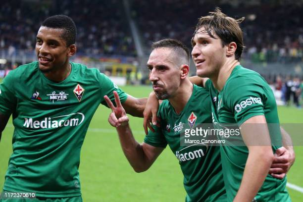 Franck Ribery of Ac Fiorentina celebrate with Federico Chiesa and Dalbert Henrique after scoring a goal during the Serie A match between Ac Milan and...