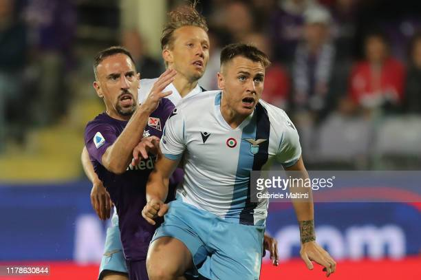 Franck Ribery of ACF Fiorentina and Lucas Leiva and Gil Patrick of SS Lazio during the Serie A match between ACF Fiorentina and SS Lazio at Stadio...