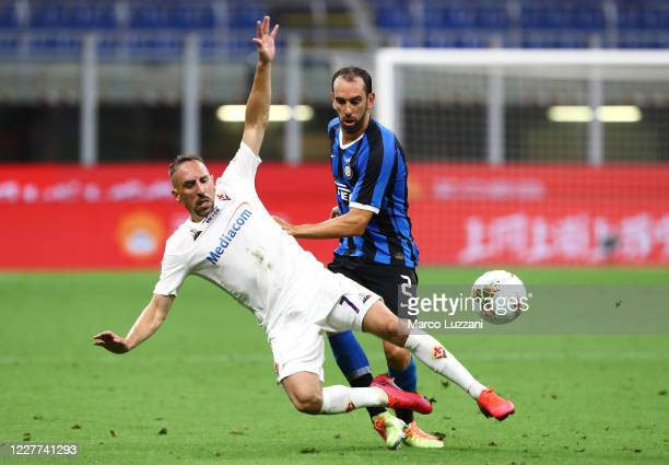 Franck Ribery of ACF Fiorentina competes for the ball with Diego Godin of FC Internazionale during the Serie A match between FC Internazionale and...