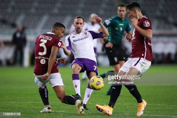 Franck Ribery of ACF Fiorentina threads the ball between Gleison Bremer and Sasa Lukic of Torino FC during the Serie A match between Torino FC and...