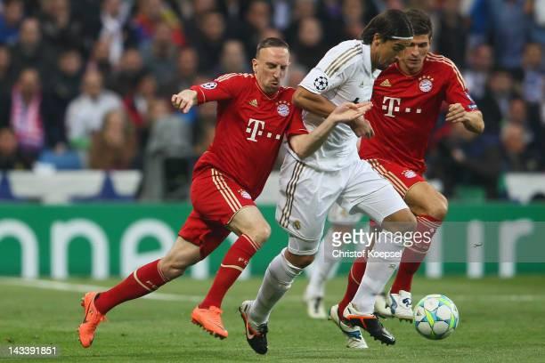Franck Ribery of Bayern and Mario Gomez of Bayern challenge Sami Khedira of Real Madrid during the UEFA Champions League semi final second leg match...
