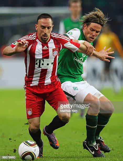 Franck Ribery of Bayern battles for the ball with Clemens Fritz of Bremen during the DFB Cup final match between SV Werder Bremen and FC Bayern...