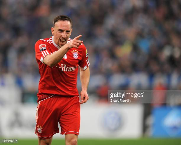 Franck Ribery of Bayern celebrates scoring his team's first goal during the Bundesliga match between FC Schalke 04 and FC Bayern Muenchen at the...