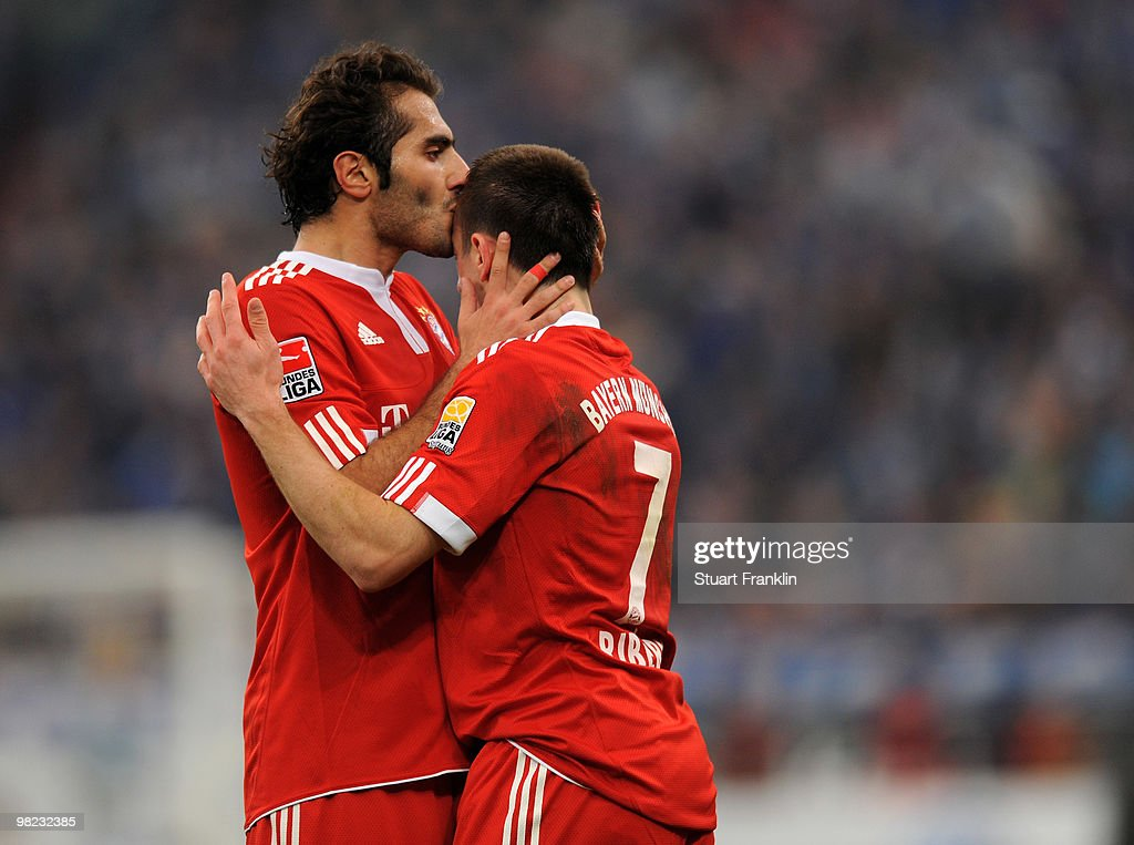 Franck Ribery of Bayern celebrates scoring his team's first goal with a kiss from Hamit Altintop during the Bundesliga match between FC Schalke 04 and FC Bayern Muenchen at the Veltins Arena on April 3, 2010 in Gelsenkirchen, Germany.