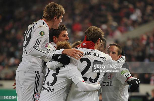 Franck Ribery of Bayern celebrates with teammates after scoring his team's opening goal during the DFB Cup Quarter Final match between VfB Stuttgart...