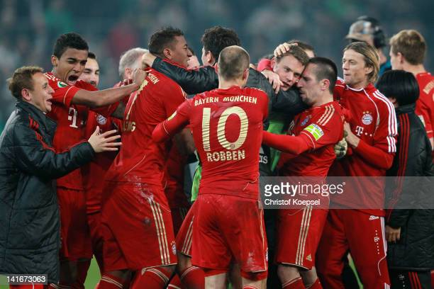 Franck Ribery of Bayern embraces Manuel Neuer after winning 4-2 after penalty shoot-out after the DFB Cup semi final match between Borussia...