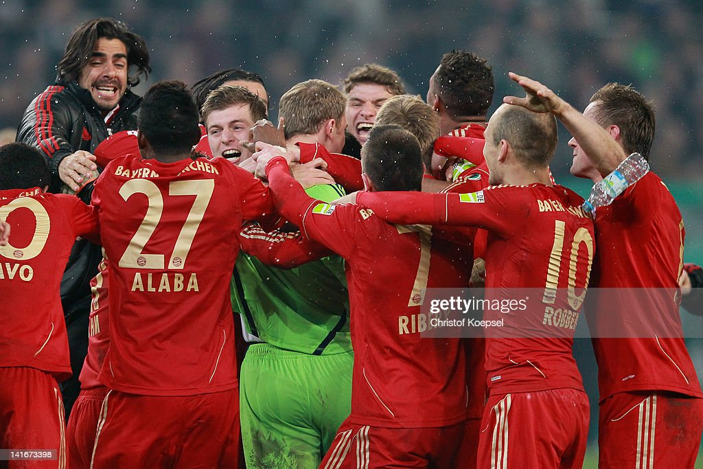 Franck Ribery (R) of Bayern embraces Manuel Neuer (3rd R) after winning 4-2 after penalty shoot-out after the DFB Cup semi final match between Borussia Moenchengladbach and FC Bayern Muenchen at Borussia Park Stadium on March 21, 2012 in Moenchengladbach, Germany.