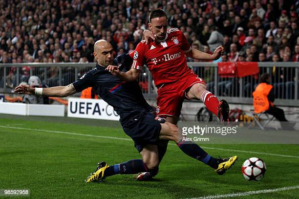 Franck Ribery of Bayern is challenged by Cris of Lyon during the UEFA Champions League semi final first leg match between FC Bayern Muenchen and...