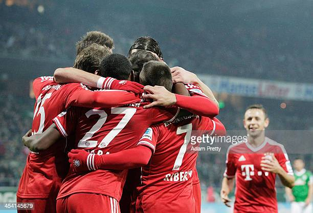 Franck Ribery of Bayern is congratulated by team mates after scoring a goal during the Bundesliga match between Werder Bremen and FC Bayern Muenchen...