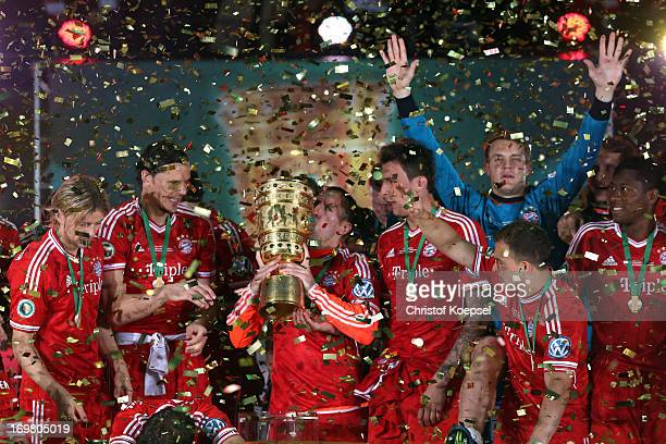 Franck Ribery of Bayern kisses the cup on the podium after winning the DFB Cup final match between FC Bayern Muenchen and VfB Stuttgart at Olympic...