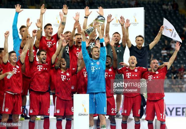 Franck Ribery of Bayern lifts the trophy after winning 5-0m the DFL Supercup match between Eintracht Frankfurt an Bayern Muenchen at...